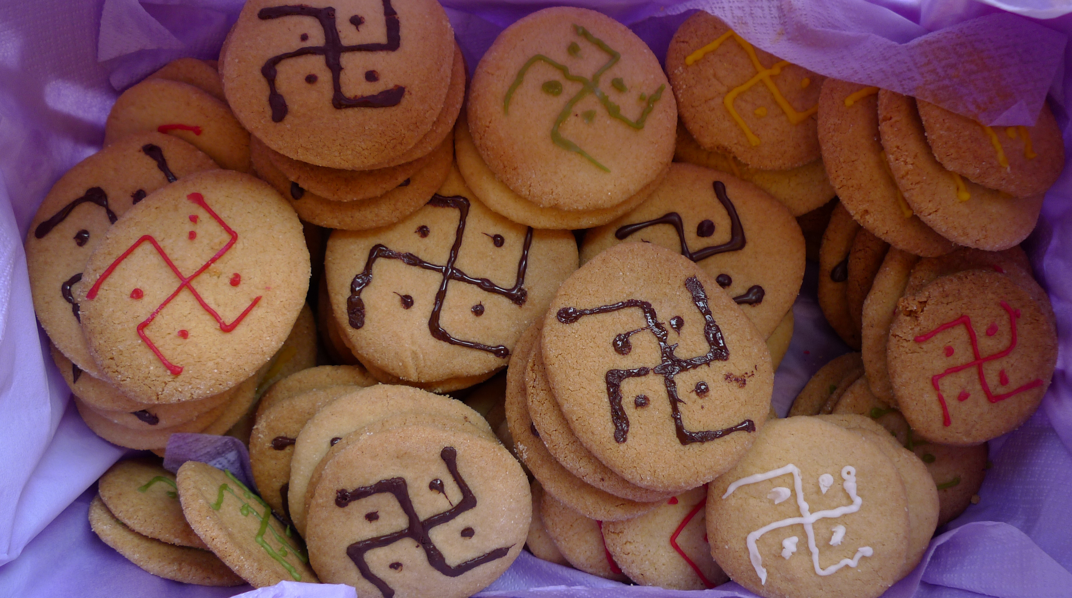 """Man woman"" swastika, cookies, ""traditional tattoo festival"""
